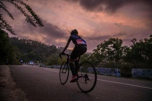 Cyclist at dusk for article 'Is cycling the best exercise for you'