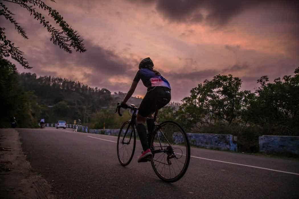 Cyclist at dusk for article 'Is cycling the best exercise for you?'